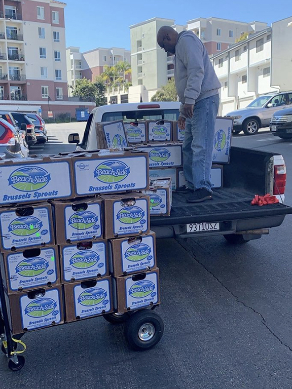Phil unloading the truck  for the  volunteers to perpare for the food drive.