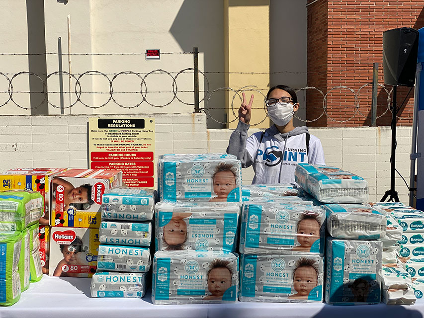 Mary J. passing out baby products at Turning Point 2021 Commnity Event